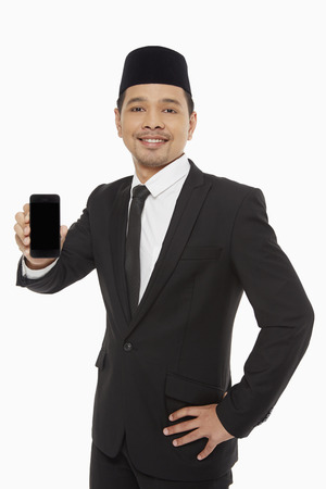 Businessman holding up a mobile phone photo