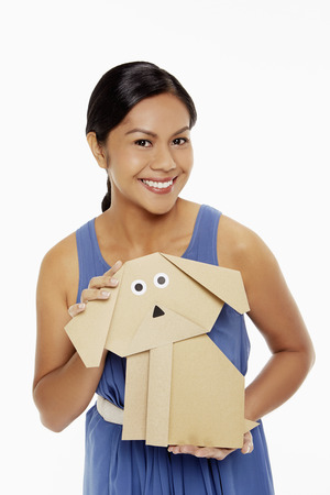 Woman holding a paper dog photo