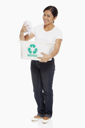 Woman holding up shredded papers photo