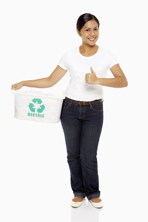 recycle logo: Woman carrying a plastic box with a Recycle logo on it, showing hand gesture