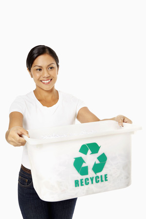 recycle logo: Woman holding out a plastic box with a Recycle logo on it