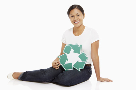 recycle logo: Woman holding up a Recycle logo Stock Photo