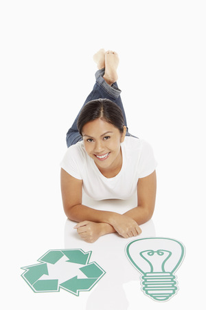 recycle logo: Woman with a Recycle logo and a cardboard light bulb Stock Photo