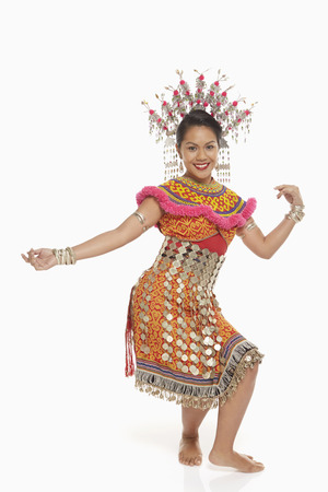 talented: Talented woman in an Iban traditional clothing dancing