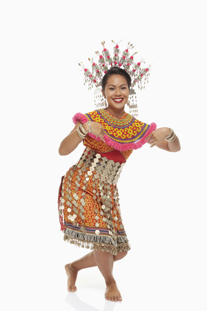 Talented woman in an Iban traditional clothing dancing photo