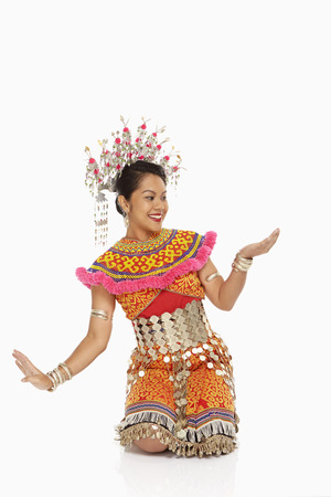 Talented woman in an Iban traditional clothing dancing