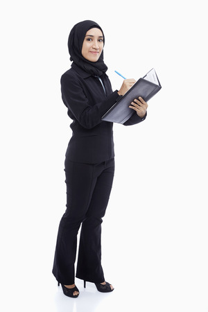 Businesswoman writing down notes photo