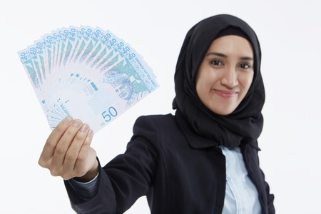 Businesswoman holding up cash photo