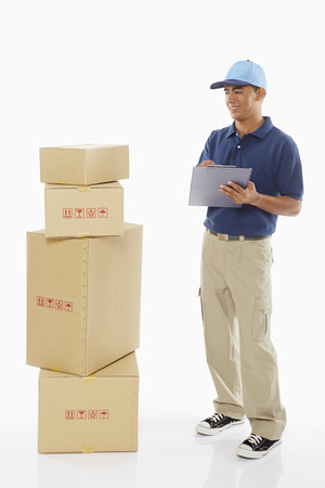 Delivery person writing notes on clipboard photo