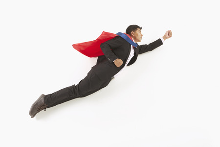 Businessman posing on the floor, flying