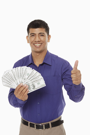 Businessman holding a lot of money photo