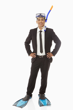silliness: Businessman with swimming gear smiling at the camera Stock Photo