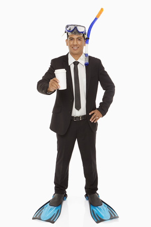silliness: Businessman with swimming gear holding a disposable cup