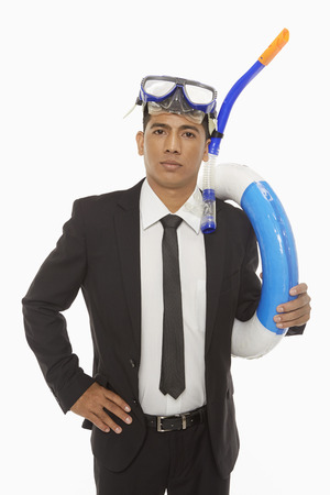 silliness: Businessman with swimming gear looking at the camera