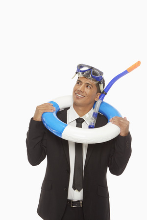 silliness: Businessman with swimming gear smiling