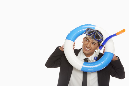 silliness: Businessman with swimming gear looking through a swimming tube