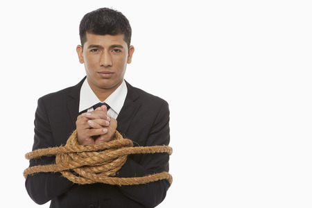 Businessman tied up and held hostage Stock Photo