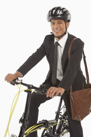 Businessman riding a bicycle photo