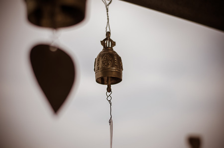 Bell hanging in pavilion on blur background Stock Photo
