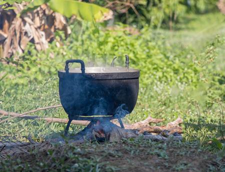campsite: Black pot cooking in the garden