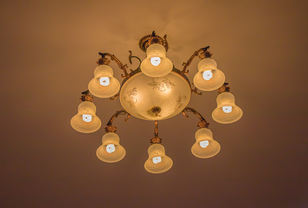 vintage furniture: Ceiling lamps for the interior of modern buildings on a dim background. Stock Photo