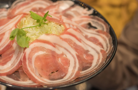 on selective soft focus of The meat is sliced thin, hot pot dishes placed on the table Stock Photo