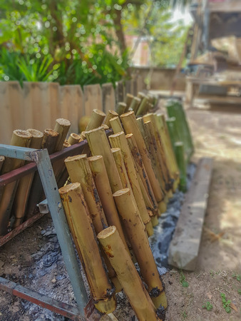 on selective focus of Glutinous Rice Grilled in Bamboo Joints,Food northeastern Thailand Stock Photo