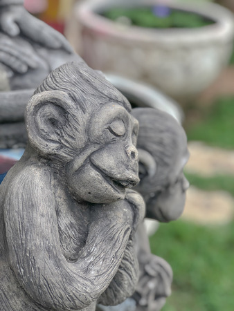 on selective focus of Statue of the monkey children and parents Smiling happily. Stock Photo