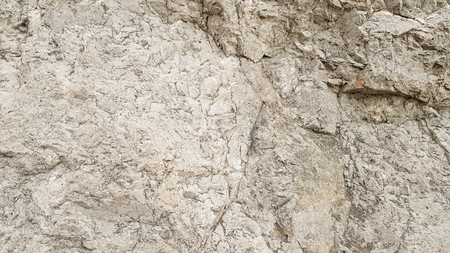 Background image of a stone wall with cracks mountains brown and gray. Stock fotó