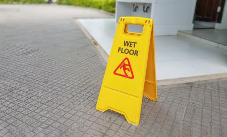 Warning label Toilet area caution wet floor Stock Photo