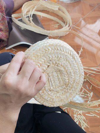 Steps to make a bamboo hat, by a group of women. In the village.