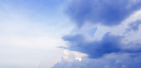 Dark gray clouds,soft white clouds and blue sky, beautiful. Beautiful natural cloud as background. 免版税图像