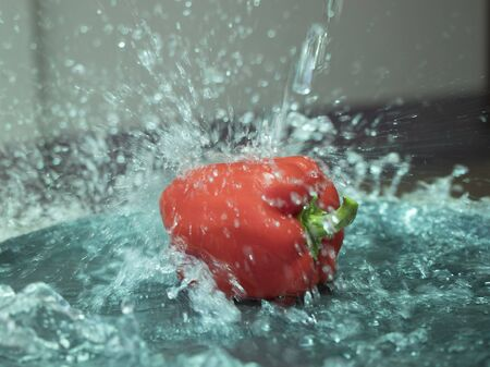 On selective focus of The chef is is washing sweet peppers with beautiful colors to cook. Banque d'images - 150088303
