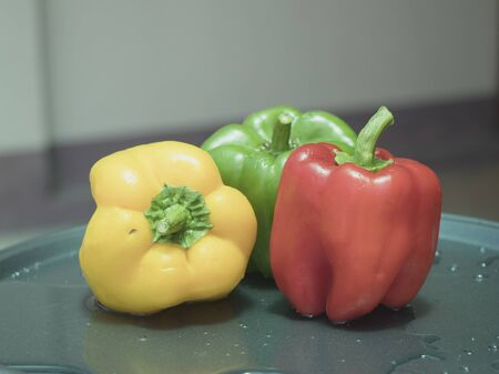 On selective focus of The chef is is washing sweet peppers with beautiful colors to cook. Banque d'images - 149153188