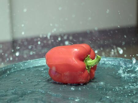 On selective focus of The chef is is washing sweet peppers with beautiful colors to cook. Banque d'images - 149177410