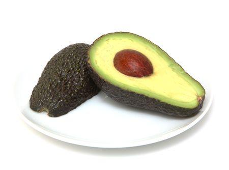 Fresh avocados cut in half Stock Photo
