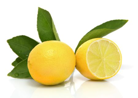 Whole and sliced organic lemons with leaves on white background Stock Photo