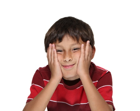 Bored Latino or Hispanic boy with head in hands on white background