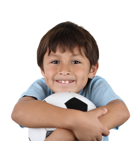 Young happy boy hugging soccer ball on white background Stock Photo