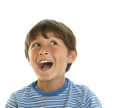 Smiling young boy shows positive attitude looking off camera isolated on white - copy space right Stock Photo
