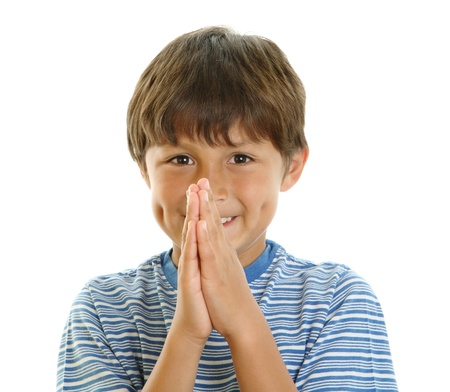 anticipating: Young boy smiling with hands together - praying or waiting in anticipation