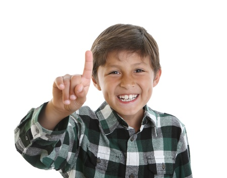 Happy boy smiling with hand showing number one next to his face - on white background photo