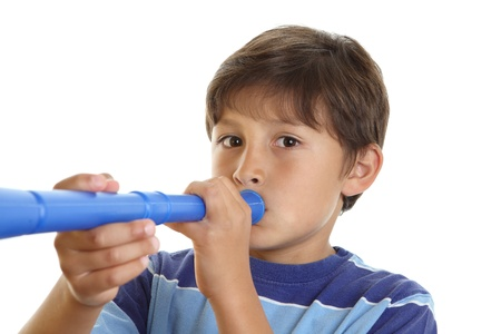 A young boy plays at blowing a blue horn toy instrument photo