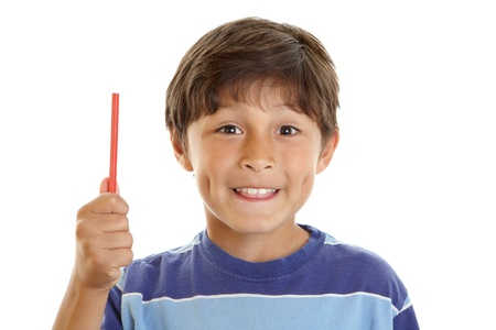 Young smiling happy boy student hold up pencil  Stock Photo