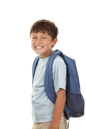 A young boy returns to school after the holidays in a cheerful mood