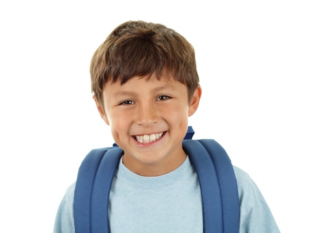 A young boy returns to school after the holidays in a cheerful mood - with his backpack Standard-Bild