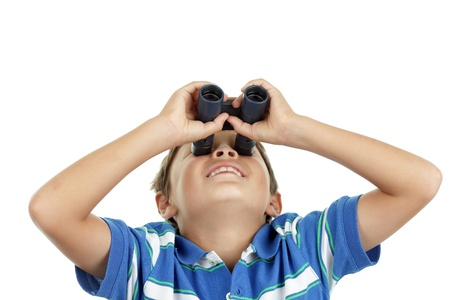 Young boy looks up through binoculars wearting blue striped shirt - on white background - landscape