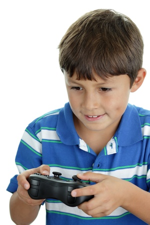 A young boy playing his favorite video game Stock Photo