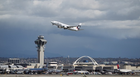 airborne vehicle: LOS ANGELES, CALIFORNIA, USA - MARCH 8, 2013 - Alaska Airlines Boeing 737-890 takes off from Los Angeles Airport on March 8, 2013. The plane has a range of 5,765 km with 160 seats.