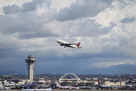 california delta: LOS ANGELES, CALIFORNIA, USA - MARCH 8, 2013 - Delta Airlines Airbus A320-212 takes off from Los Angeles Airport on March 8, 2013. The plane has a range of 5,900 km with 150 seats.